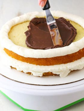 adding chocolate ganache (How to Stack a Cake Tutorial)
