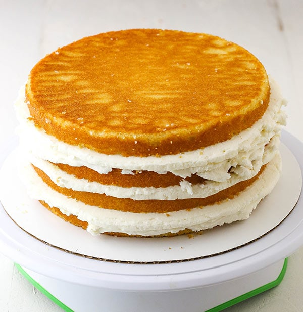 a stacked cake with three fillings