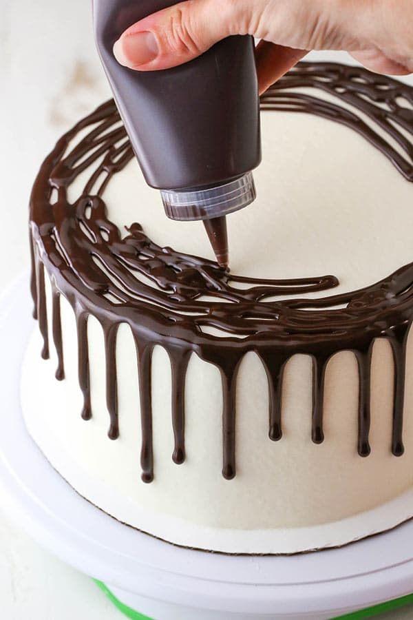 filling in the center of the cake with chocolate ganache