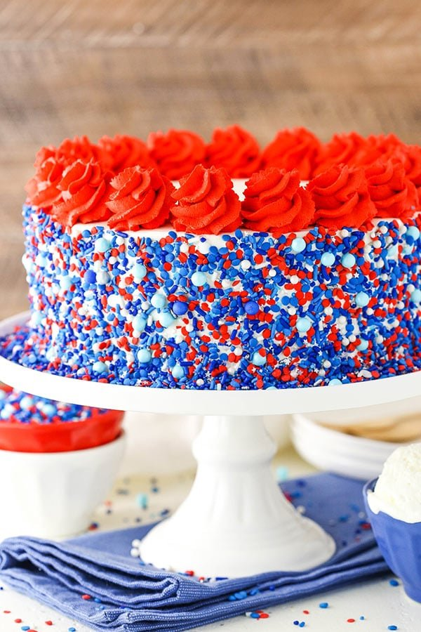 red white and blue ice cream cake with sprinkles all over the sides