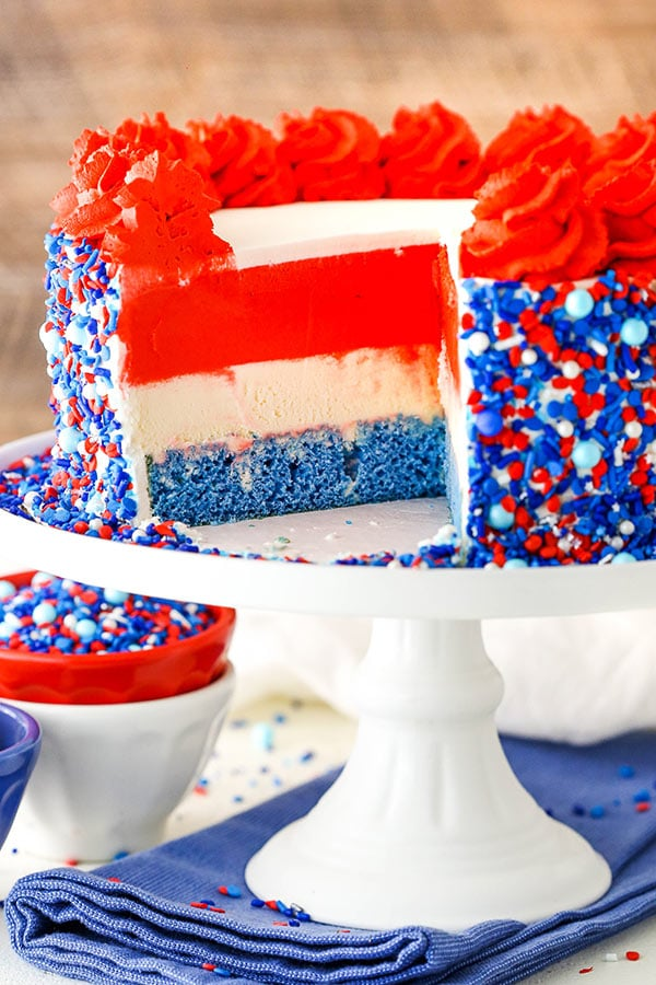 ice cream cake with a slice cut out to reveal red white and blue layers