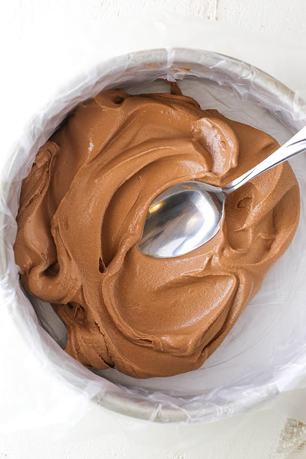 adding ice cream to a cake pan