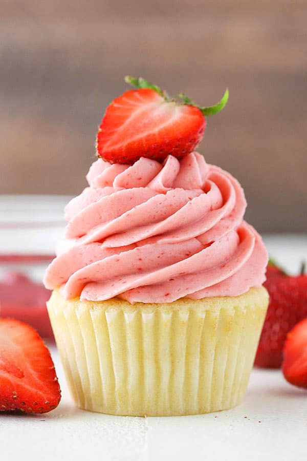 cupcake with strawberry frosting on top from the side