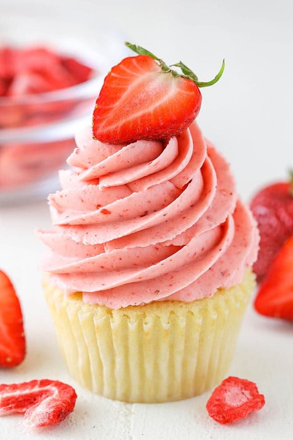 close up of homemade strawberry frosting on top of a cupcake