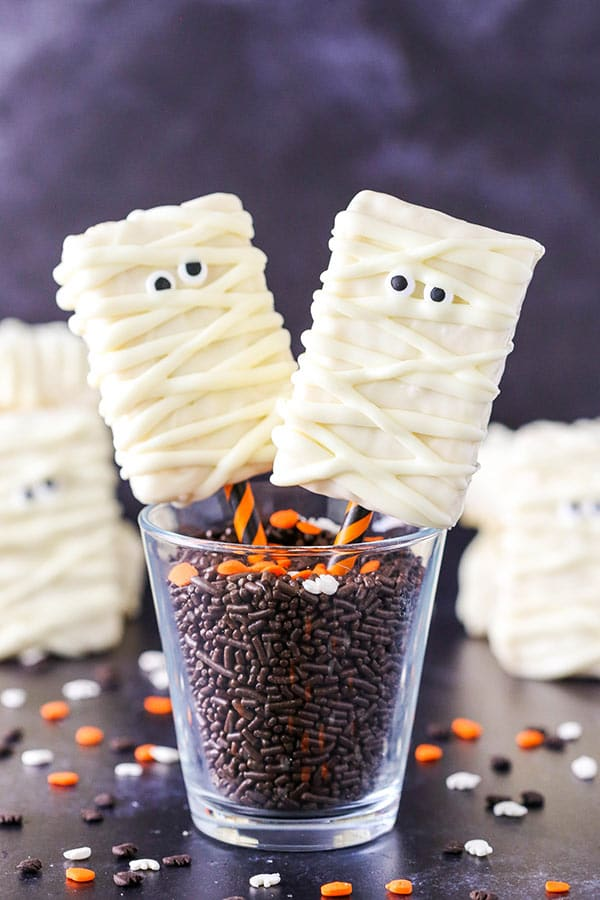 These Mummy Rice Krispie Treats are delicious and easy to make with only three ingredients! They are the perfect Halloween treat and great for kids parties!