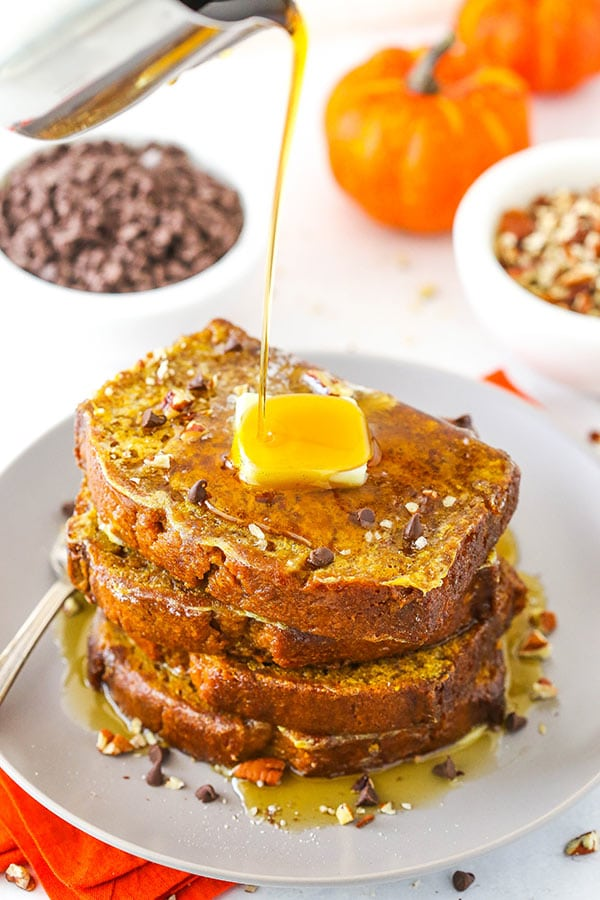 pouring syrup onto pumpkin bread french toast