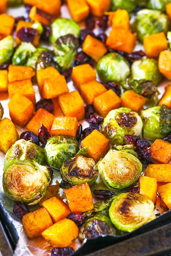 brussels sprouts and squash on cookie sheet