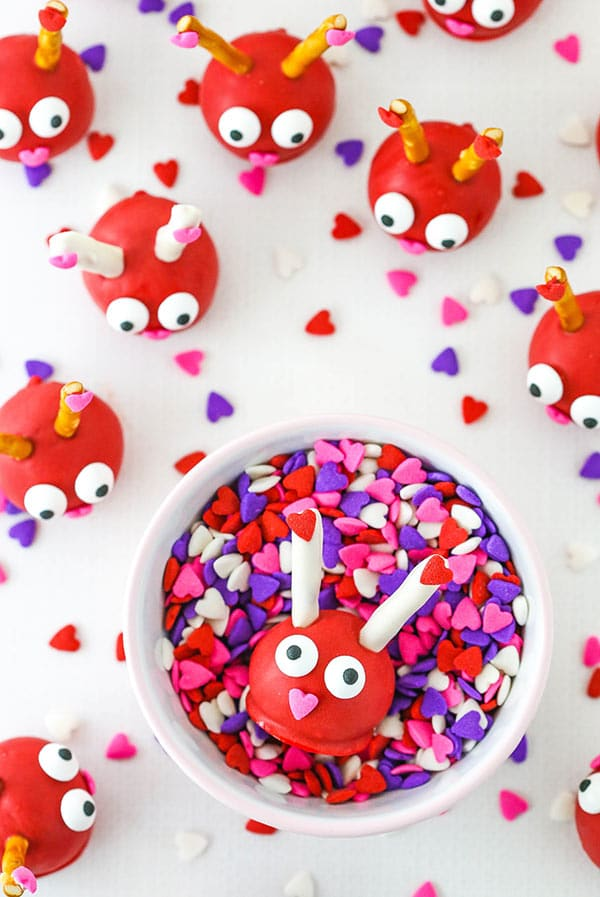 Love Bug Oreo Cookie Balls in cup of sprinkles close up
