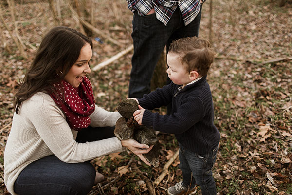 image of Ashton handing rocks to Lindsay