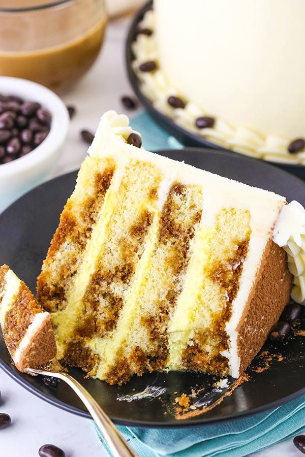 Tiramisu Layer Cake - layers of vanilla cake drizzled with espresso and kahlua and filled with tiramisu filling!