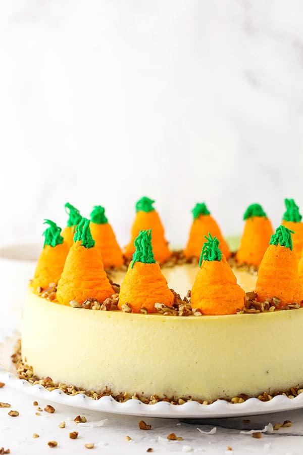 side image of cheesecake and whipped cream carrots