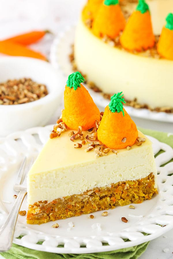 carrot cake cheesecake slice on plate