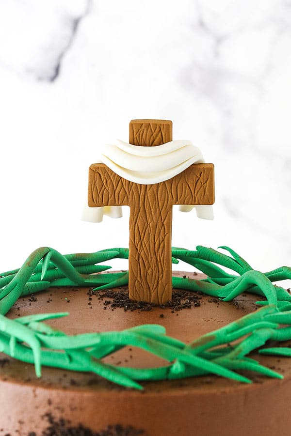 close up of cross on cake
