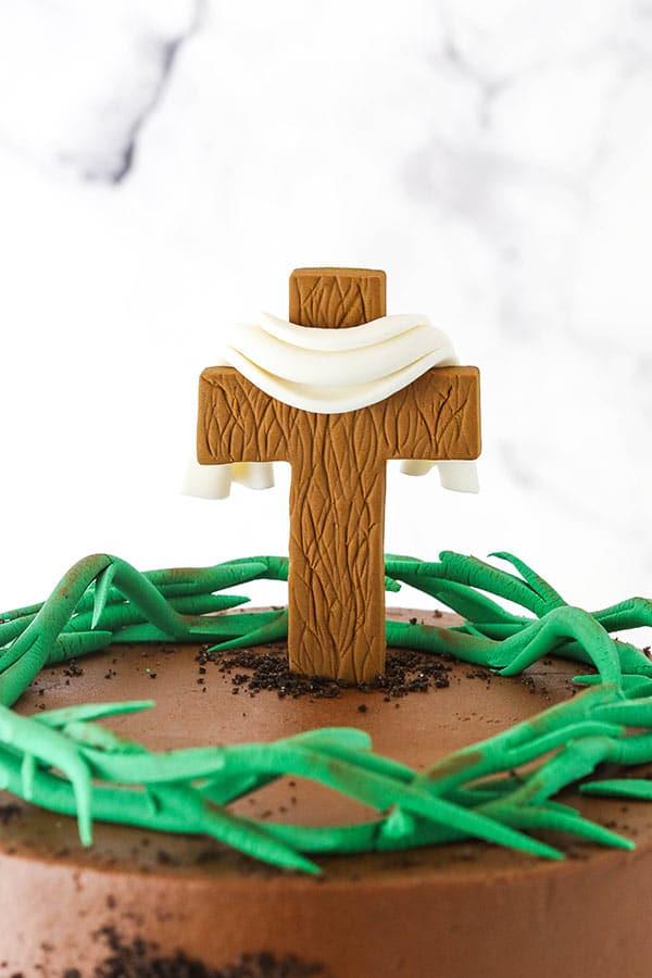 close up of cross on cake