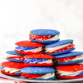 cookie sandwiches stacked on a silver plate