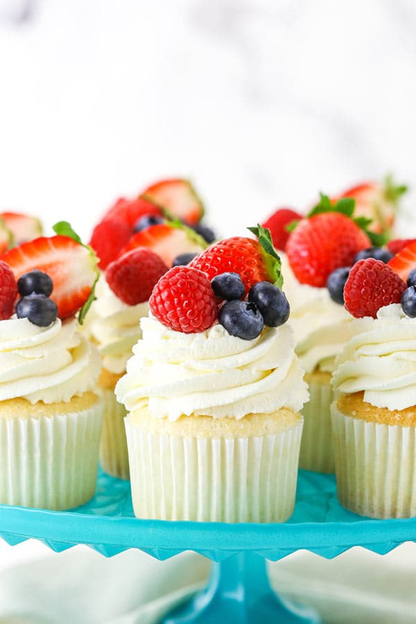 Fluffy Angel Food Cupcakes with Whipped Cream Frosting & Fresh Berries