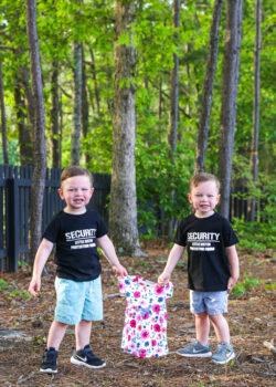 ashton and brooks holding a little girl dress