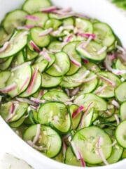 cucumber salad in white dish - angled shot