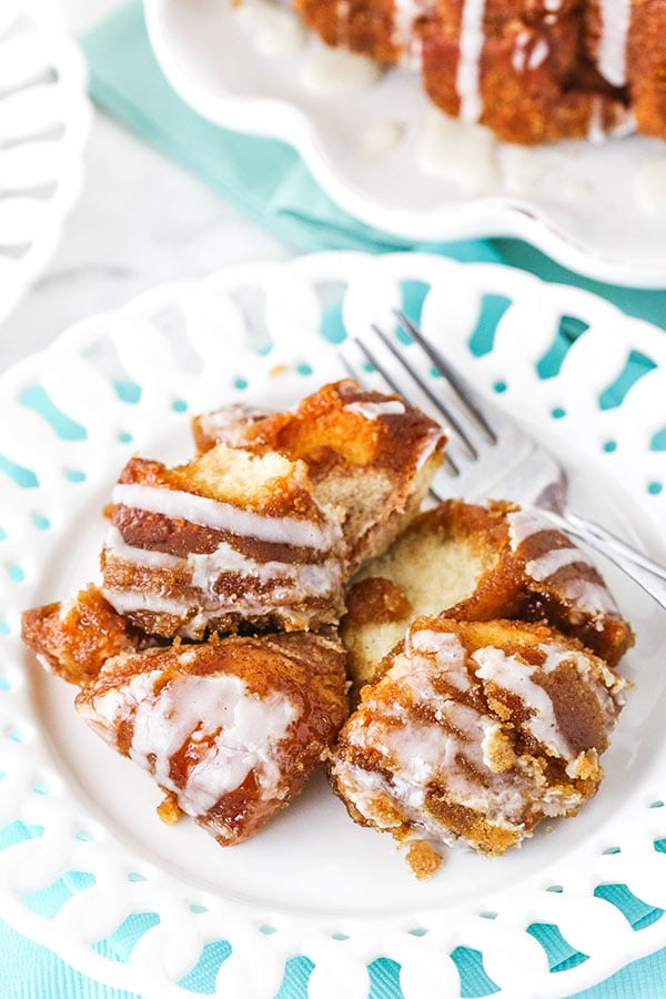 A white plate and fork with fluffy pieces of homemade monkey bread.