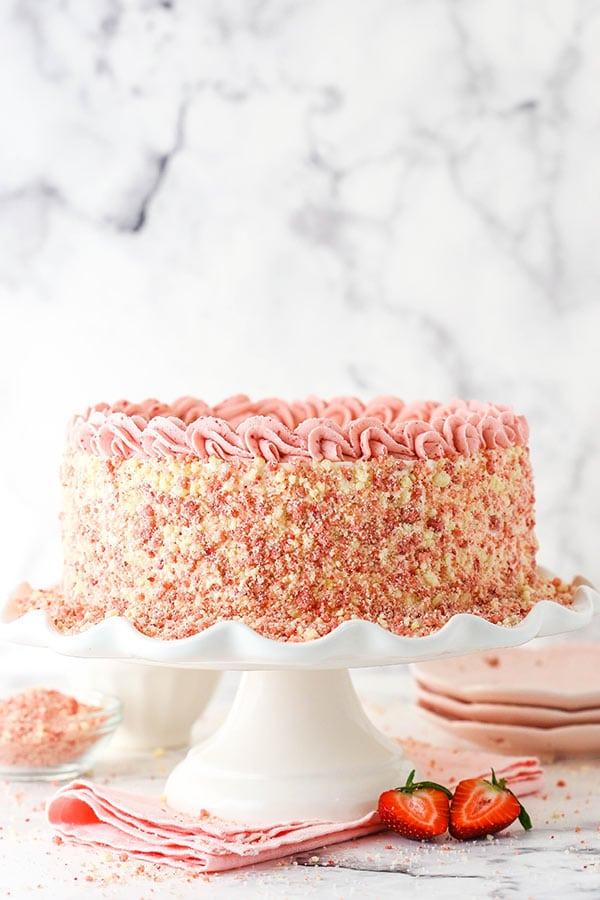 Full ice cream cake on white ruffle cake stand