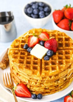 overhead of waffles on white plate without syrup