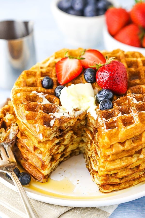 stack of waffles with bite cut out