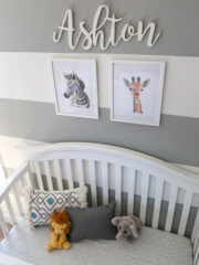 close up of Ashton's crib, photo hangings