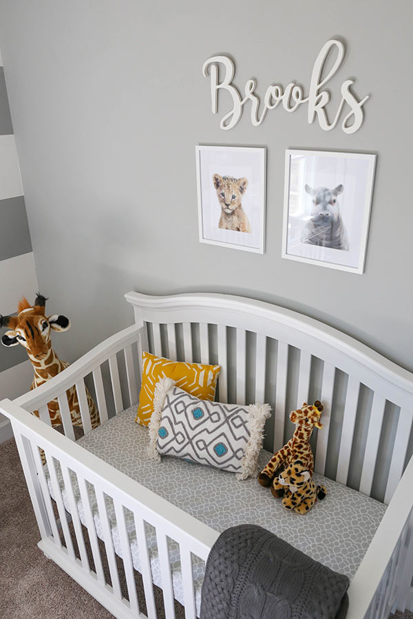 Brooks' Crib with a Lion Cub and Hippo Painting Hanging on the Wall Above