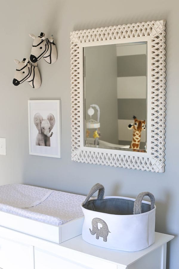 The Mirror Above the Changing Table with Animal Decorations on the Wall