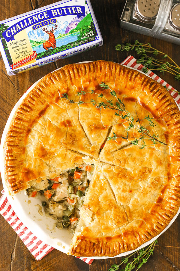 chicken pot pie with a slice taken and challenge butter package