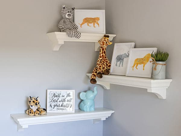 Three Floating Shelves on the Nursery Wall Displaying Animal Safari Decor