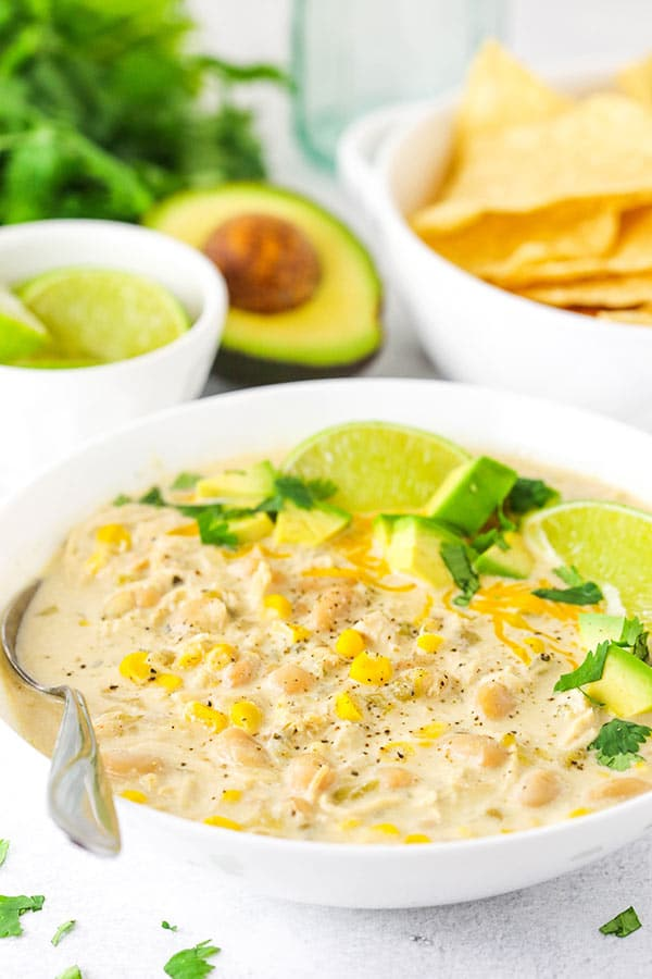 A Serving of White Chicken Chili with an Avocado and Tortilla Chips