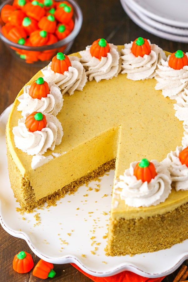 A Pumpkin Cheesecake With A Slice Removed