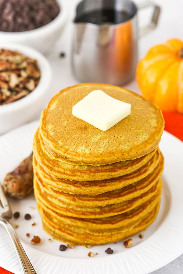 Fluffy Pumpkin Pancakes Topped with a Square of Butter