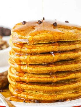 Seven Super Fluffy Pumpkin Pancakes Stacked on a Plate