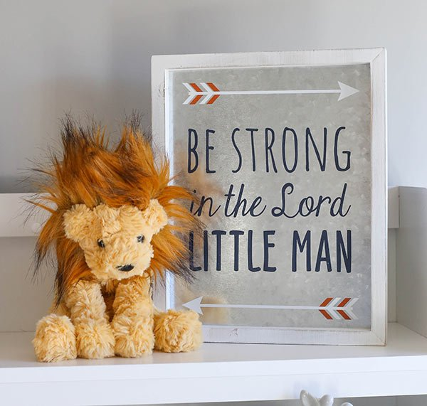 "A Little Stuffed Lion on a Shelf Next to ""Be Strong in the Lord"" Decor"