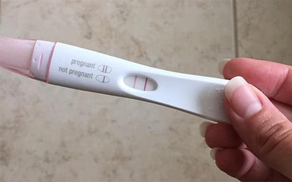 Lindsay's Hand Holding a Positive Pregnancy Test