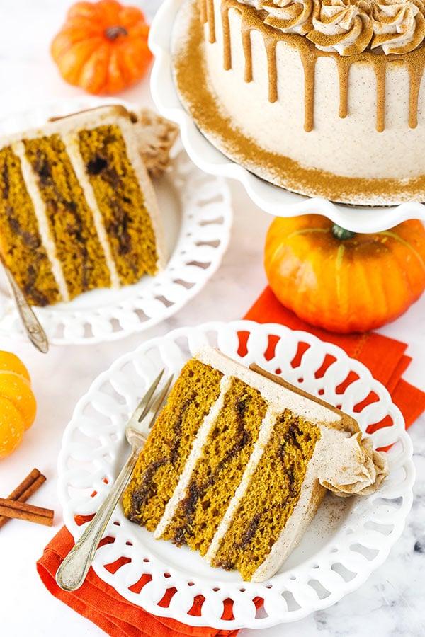 two slices of cinnamon sugar pumpkin layer cake