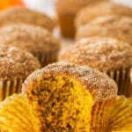 cinnamon sugar pumpkin muffin with bite taken out