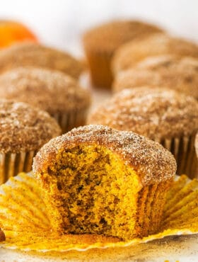 cinnamon sugar pumpkin muffin with bite taken out