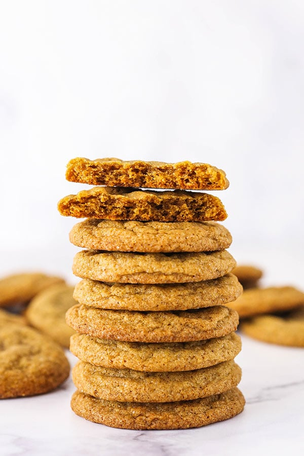 A Tall Stack of Molasses Cookies With the Top one Cut in Half