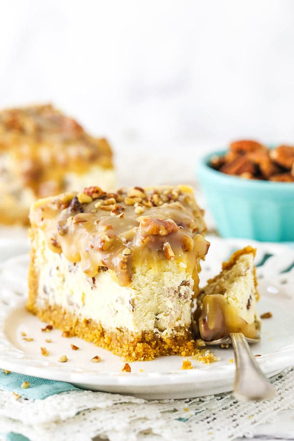 pecan praline cheesecake with a bite taken