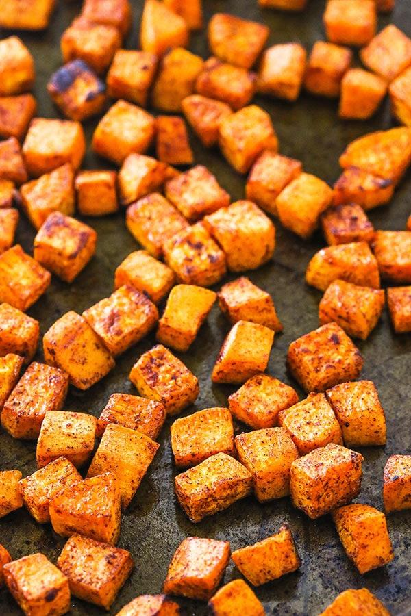 Roasted Sweet Potatoes Arranged on a Baking Pan