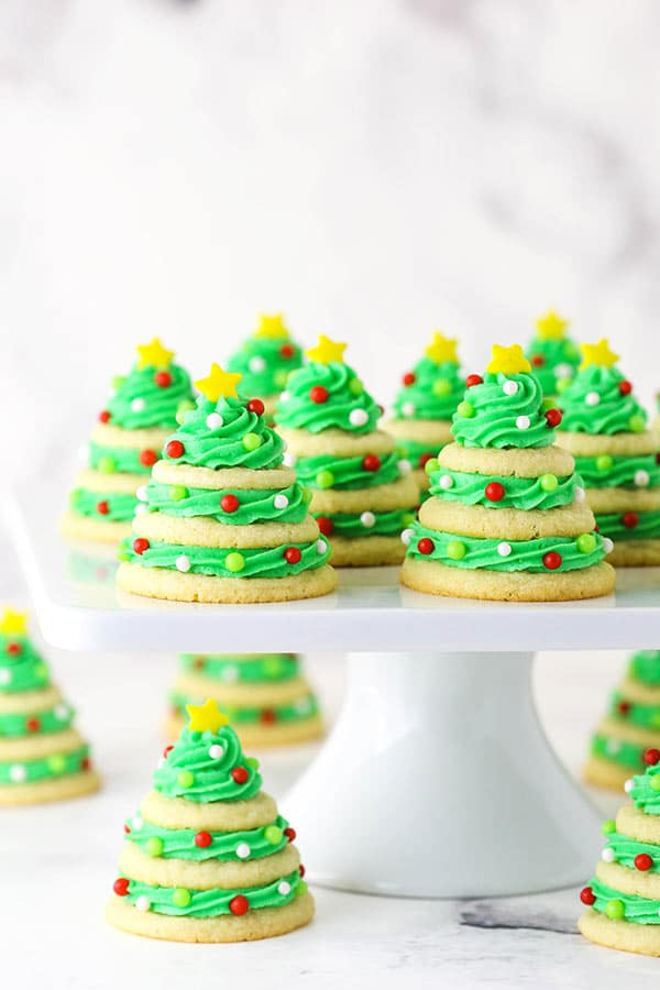 sugar cookie christmas trees on white cake stand