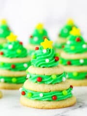 stacked sugar cookie christmas trees on marble table