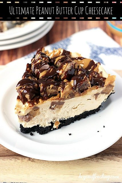 A Big Piece of Peanut Butter Cup Cheesecake on a Plate at the Edge of the Table