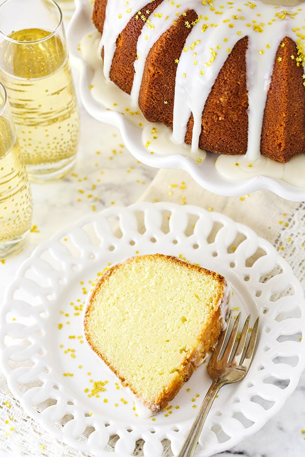 A Slice of Pound Cake on a Plate Next to Two Glasses of Champagne