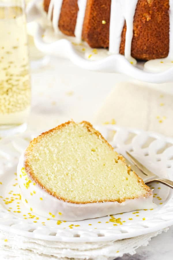A Slice of Champagne Pound Cake with Star-Shaped Sprinkles on a Plate
