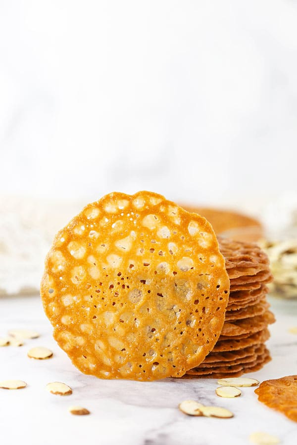 A Single Lace Cookie Propped Up Against a Stack of More Cookies