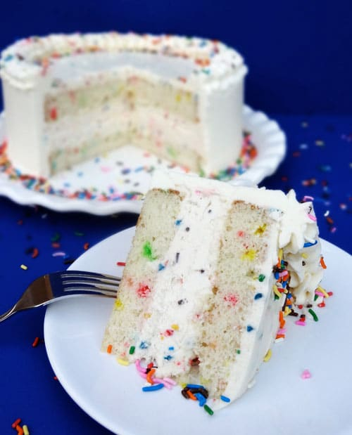 A Slice of Funfetti Cake Batter Ice Cream Cake on a Plate with a Fork
